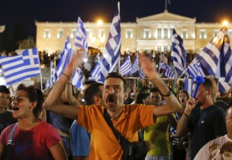 Greek No supporters celebrate the initial exit poll results from the referendum that placed No at 61.3% of the vote and and Yes at 38.6%
