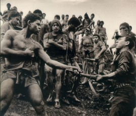 Photo by Sebastiao Salgado of a striking miner educating a soldier in Brazil