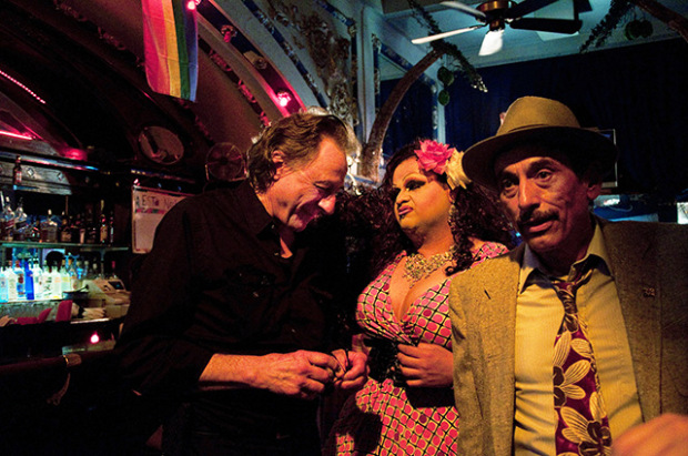Producer Lou Dematteis, Latino drag performer Lulu Ramirez and author Alejandro Murguía at the Esta Noche nightclub during the filming of SFNoir on July 19, 2012. The Esta Noche is now closed, a victim of the changing demographics of the Mission District.