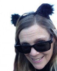 "Madelaine Kelly.  ""I put on the cat ears and then forget I have them on but other people look at me and smile.  So, I am surrounded by smiles all day long."""