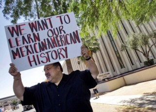 Carlos Galindo protests Monday, May 9, 2011 outside the Arizona Department of Education in Phoenix, along with other supporters of an ethnic studies program in the Tucson Unified School District. About a dozen people showed up Monday and held signs accusing the department of a policy of attacking Arizona Latinos after former school's chief Tom Horne declared the program a violation of state law and called for its elimination hours before his term ended and he became Arizona Attorney General. (AP Photo/Matt York)