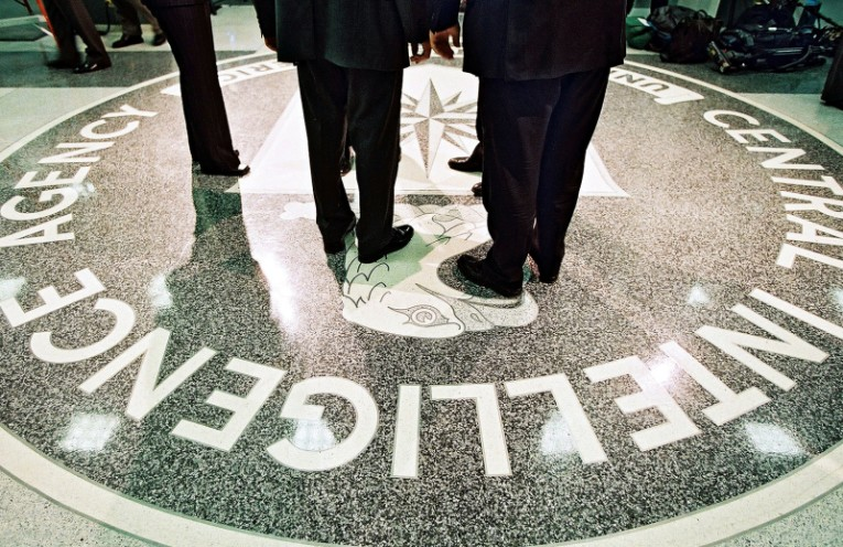 FILE -- President George W. Bush and CIA Director George Tenet stand on the agency's seal at CIA headquarters in Langley, Va., March 20, 2001. In more than 500 pages, the Senate Intelligence Committee's summary, released on Tuesday, paints a devastating picture of a CIA ill equipped to take on the task of questioning Al Qaida suspects, bungled the job and then misrepresented the results. (David Burnett/Pool via The New York Times) -- FOR EDITORIAL USE ONLY. XNYT12