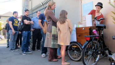 Curbside Creamery's Tori Wentworth dishes out free samples at a recent First Friday event held in Oakland's Temescal Alley.