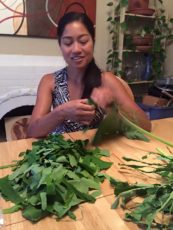 Aileen Suzara preparing taro leaves