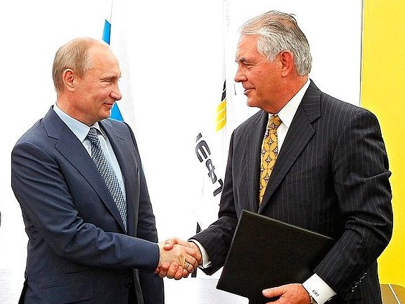 Vladimir Putin shakes hands with President and Chairman of ExxonMobil Rex Tillerson over joint development of difficult-to-access reserves in western Siberia in June 2012.