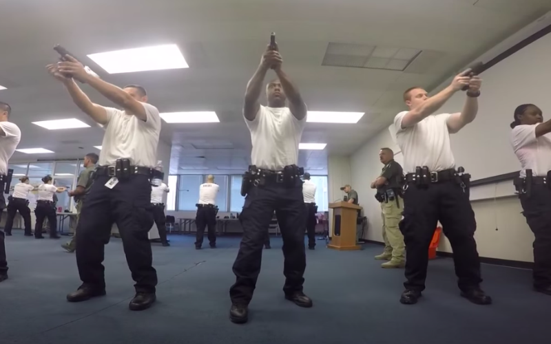 Oakland police trainees aim weapons in promotional video